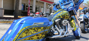 picture of a blue motorcycle with hydro dipped graphics on the body, hydro dipping custom motorcycle with yellow graphics