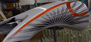 picture of a hydro dipped motorcycle gas tank with white orange and grey swirl design water transfer printed onto it