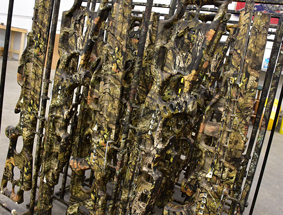 hydrographics, picture of a weapons rack that was dipped with camouflage hydrographics