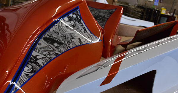 picture of an orange motorcycle with hydro dipped graphics on it, hydro dipping custom motorcycle