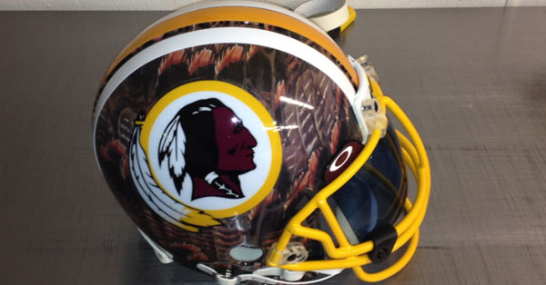 washington redskins football helmet with hydrographic feathers on it