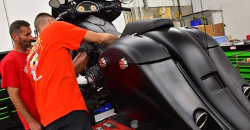 splashed hydrographics professionals working on an indian motorcycle after matching the matte black color, hydro dipping work on a indian motorcycle, hydrographics photo gallery