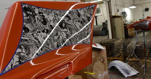picture if a hydro dipped motorcycle part with naked women graphic, water transfer printed motorcycle part with a black and white naked women graphic printed on it, splashed hydrographics, hydrographics photo gallery